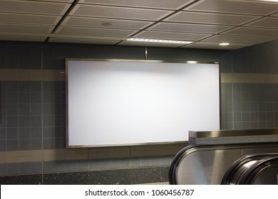 Blank advertising board on the wall, in underground station.