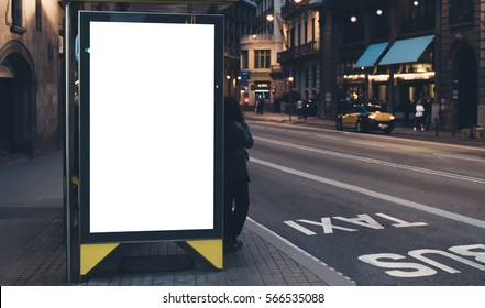 Blank advertising light box on bus stop, mockup of empty ad billboard on night bus station, template banner on background city street for poster or sign, afisha board and headlights of taxi cars