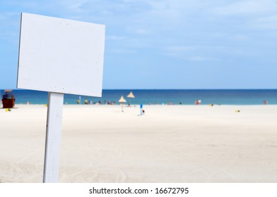 Blank advertising post at the beach