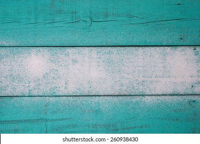 Blank antique teal blue wood beach sign with sand texture