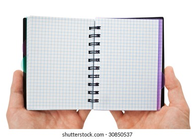 blank background. paper spiral notebook in hands isolated on white