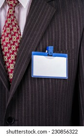 Blank badge blue plastic on a business suit manager