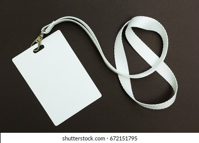 Blank badge or ID pass isolated on brown background, clipping path included