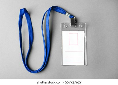 Blank badge with lanyard on grey background