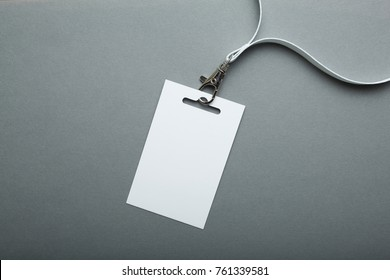 Blank badge mockup isolated on grey clipping path. Name Tag with ribbon, Corporate design.