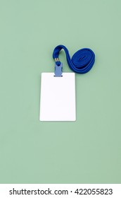 Blank badge template in plastic holder with blue strap  magnetic key