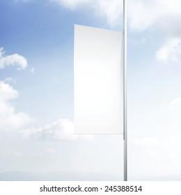 Blank banner flag against the sky.