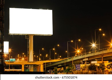 Blank big billboard night background for your advertising,put your own text here,isolate white on board