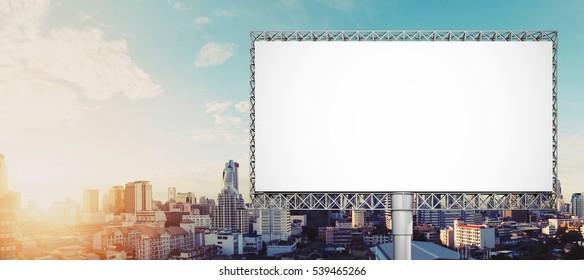 Blank billboard for advertisement at Bangkok city in sunrise