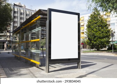 Blank billboard for advertisement, in a bus stop at the street