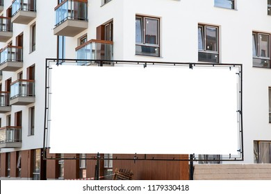 Blank billboard advertisement in the front of new builded residential building
