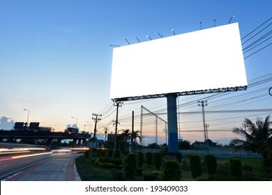 Blank billboard for advertisement at twilight