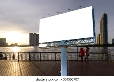 Blank billboard for advertising with night cityscape background.