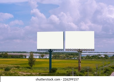 Blank billboard against blue sky on day noon light..