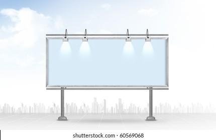 Blank billboard against a city background
