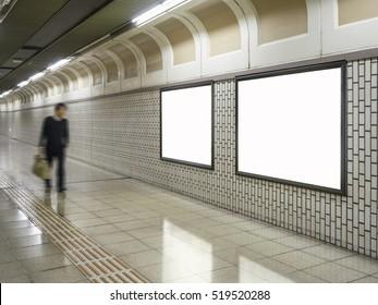 Blank Billboard Banner Media Light box Subway station with blurred Businessman