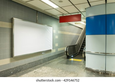 Blank billboard beside escalator in subway. Useful for your advertising.