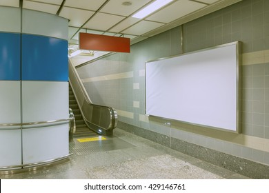 Blank billboard beside escalator in subway. Useful for your advertising.(V-log Style)
