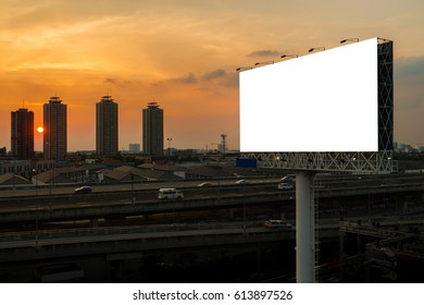 blank billboard beside express way at beautiful sunset used for advertising