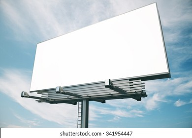 Blank billboard at blue sky background, mock up