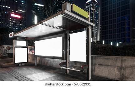 Blank billboard at bus stop at night in city of China.