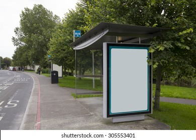 Blank billboard in a bus stop, urban landscape