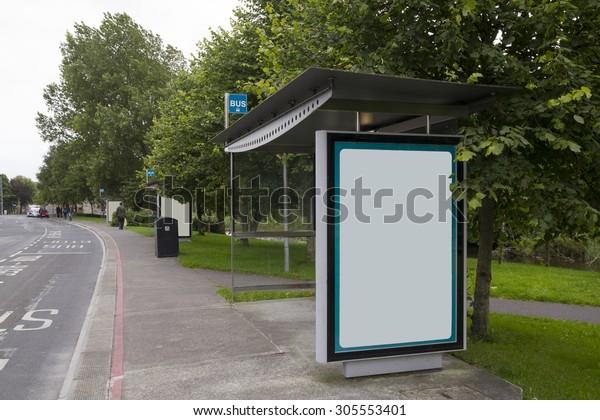 Blank billboard in a bus stop, urban landscape
