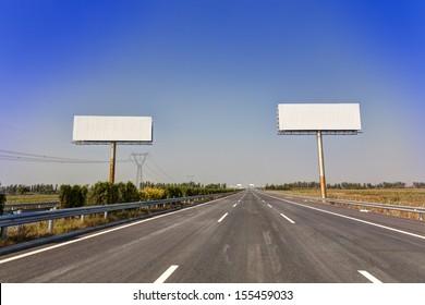 Blank billboard by the highway