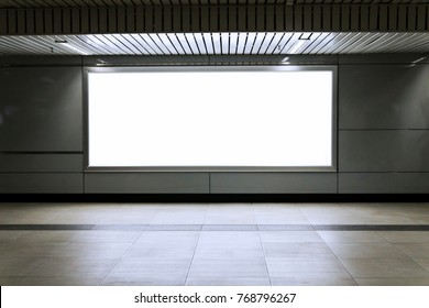 Blank billboard in the city building, shot in subway station