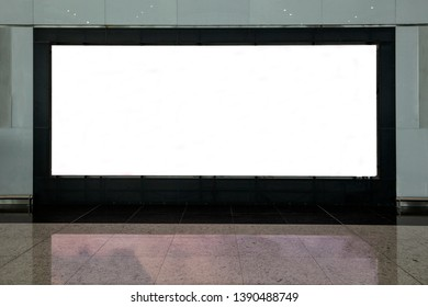 Blank billboard with clean space for publicity content or text message, advertising mock up in interior, public commercial board in waiting of airport hall with empty chairs, template banner indoors.