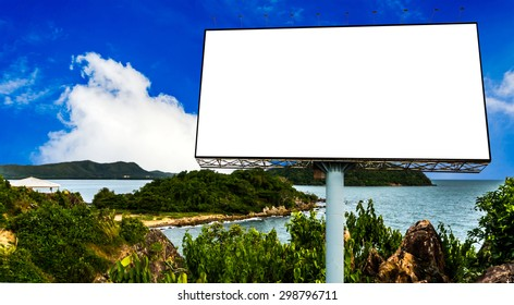 blank billboard with cloudy blue sky and ocean view background.