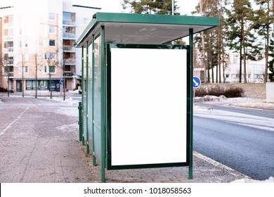 Blank billboard with copy space area for your text message or promotional content, public information board in urban setting, city bus stop with empty mock up banner for your advertising