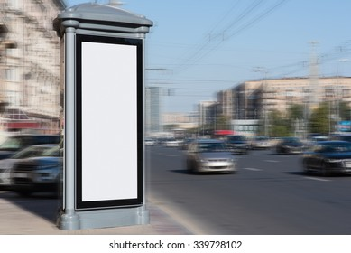 Blank billboard with copy space area for your text message or promotional content, empty public information board in urban setting, white advertising mock up banner in metropolitan city in daytime