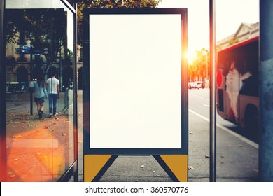 Blank billboard with copy space area for your text message or promotional content, public information board in urban setting, metropolitan city bus stop with empty mock up banner for your advertising