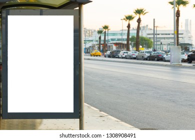 Blank billboard with copy space for your text message or promotional content, public information board on the street, advertising mock up empty banner in metropolitan city, Clear poster on a bus stop.