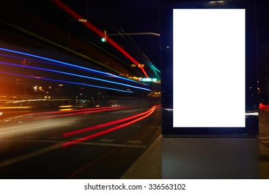 Blank billboard with copy space for your text message or promotional content, public information board in night city with shutter speed on background, empty advertising mock up banner on roadway