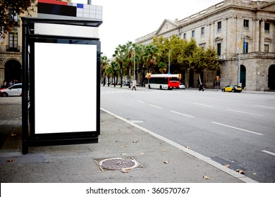 Blank billboard with copy space for your text message or promotional content, public information board in urban setting,bus stop Light box or advertising mock up with empty banner in metropolitan city