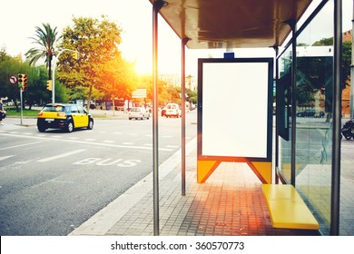 Blank billboard with copy space for your text message or promotional content, empty public information board in the big city, advertising mock up empty banner in metropolitan city on a bus station