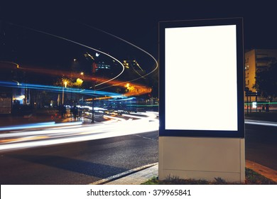 Blank billboard with copy space for your advertising text message or content, public information board in night city with shutter speed on background, empty promotional mock up Light-box on roadway