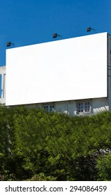 Blank billboard at daylight for advertisement, white billboard on sky background,