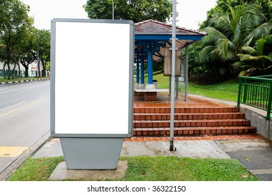 Blank billboard display at bus stop with clipping path for your advertising