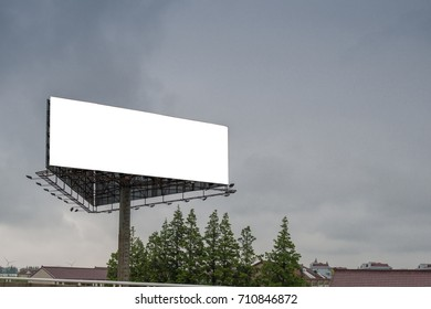 Blank billboard with empty screen on cloudy sky background