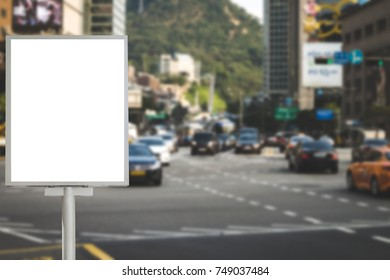 Blank billboard for information on bus stop beside the road, traffic road blurred background ,commercial, marketing and advertisement concept