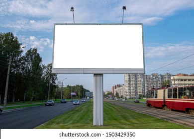blank billboard, a large billboard on the background of the park and the street. UPS mock up isolated on white.