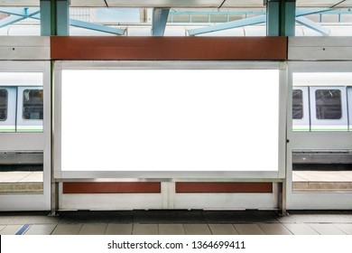 Blank billboard LCD advertisement for adjust your message in electric train station, mockup selective focus with clipping path.