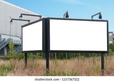Blank billboard with lights in a field