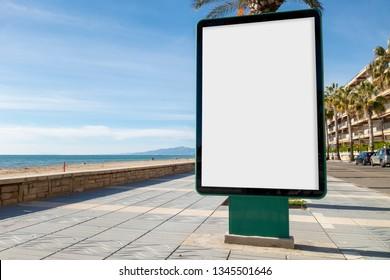 Blank billboard mock up next to the beach