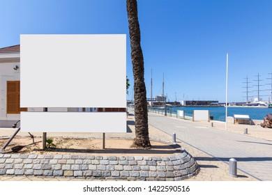 Blank billboard mock up next to the sea