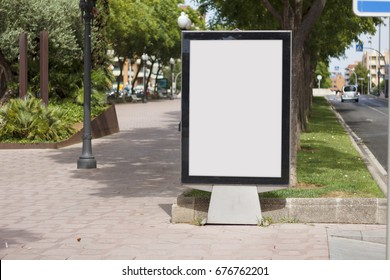 Blank billboard mock up in a park