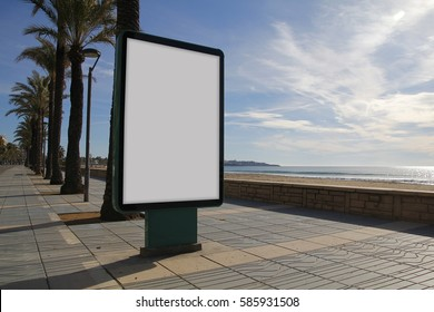 Blank billboard mock up in a sidewalk, next to the sea
